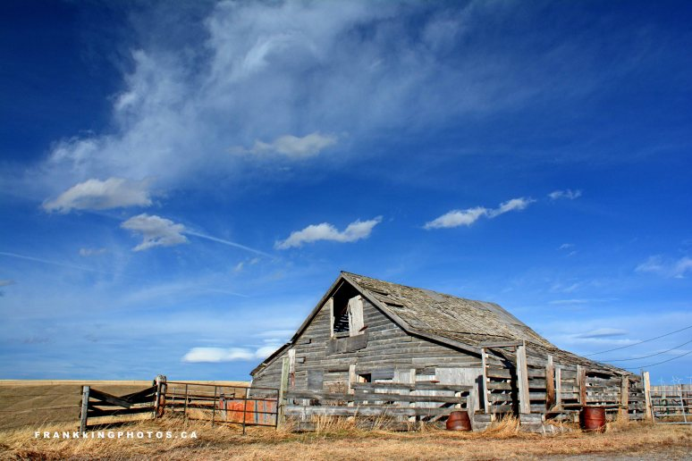 Pincher Creek Alberta old barn blue sky prairies